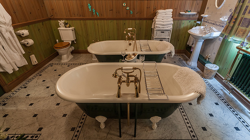 His & Hers Roll-top bathtubs